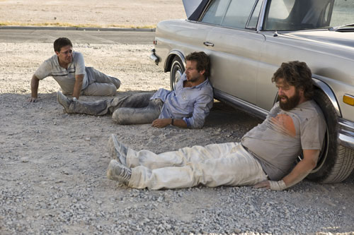Bradley Cooper, Ed Helms, Zach Galifianakis - lying in the dirt - The Hangover