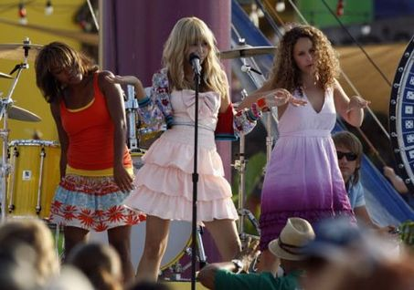 Miley Cyrus on stage as Hannah Montana