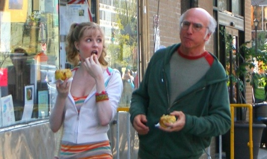 Evan Rachel Wood in pigtails makes a stark contrast to the older Larry David
