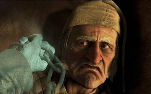 Jim Carey as Ebbenezer Scrooge looks at the ghastly hand of Jacob Marley