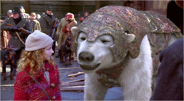 Dakota Blue Richards and Amoured Bear from The Golden Compass